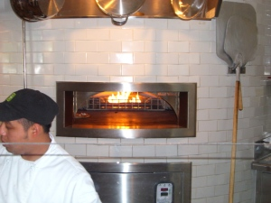 All the pizzas are cooked in a wood burning oven.